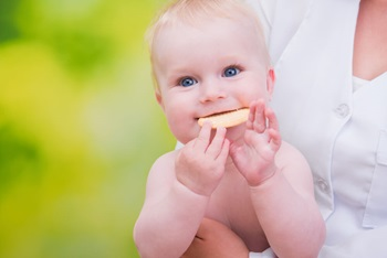 smiling funny baby eats cookies