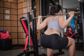 woman performing a squat in the gym