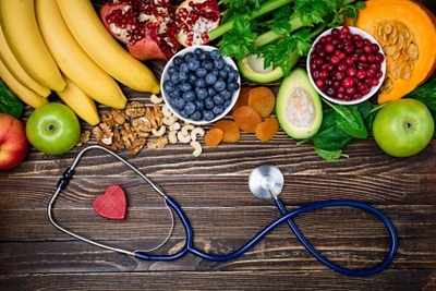 Variety of healthy heart foods and a stethoscope