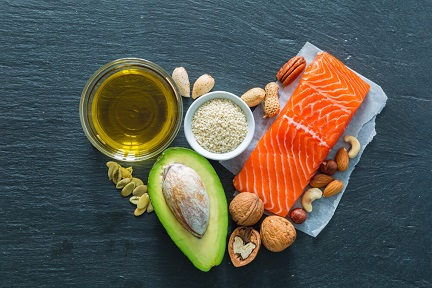 Collection of good fats like nuts, fish and avocado