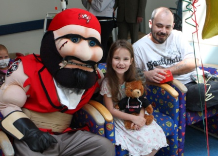 little girl with pirate mascot