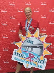 Nancy O. holding an Iron Girl race placard